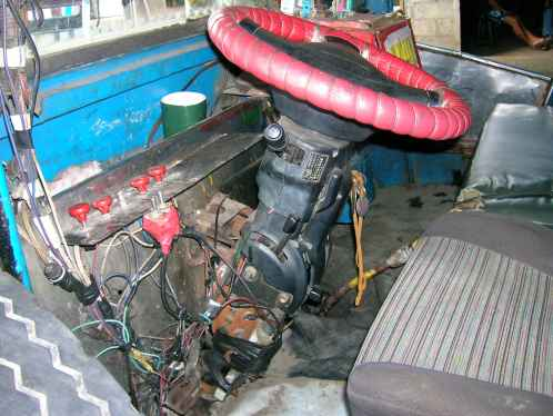 A weird wired cockpit of a jeepney, but it works.